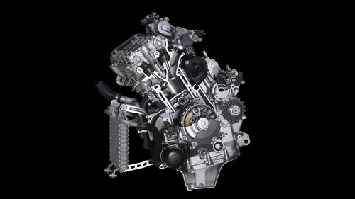 In questa vista del motore Yamaha parzialmente sezionato si possono notare i bilancieri a dito (al posto delle punterie a bicchiere impiegate in precedenza) e una delle due masse eccentriche dell'albero ausiliario di equilibratura, posto nella parte anteriore del basamento. La ridotta lunghezza è rimarchevole